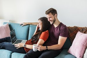 Couple relaxing together at home