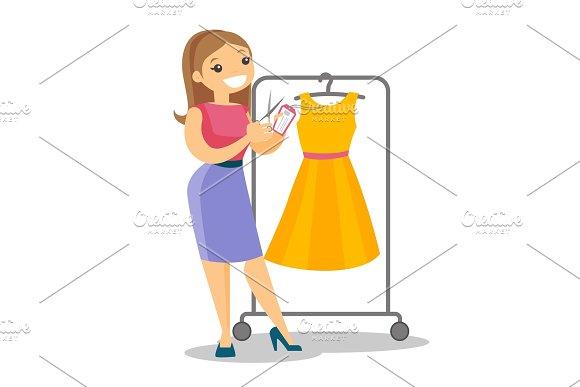 Caucasian Woman Cutting Price Tag Off New Dress