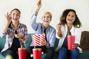 Young women enjoying a movie