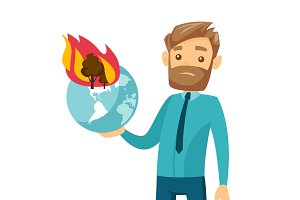 Caucasian man holding globe with forest in fire.