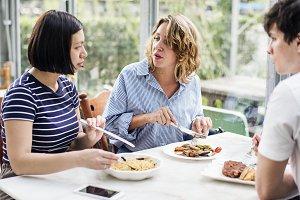 Friends eating food together
