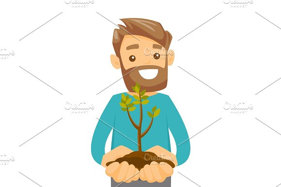 Caucasian White Man Holding Green Plant In Soil