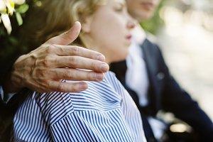Man consoling an upset girlfriend
