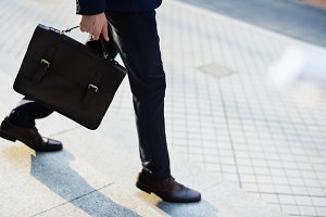 Man carrying his bag to work