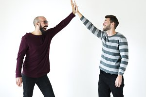 Two men giving a high five