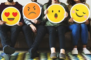 Group of people holding emoticon
