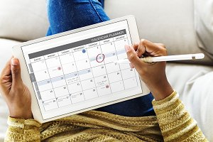 Woman checking calendar (PSD)