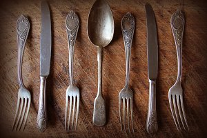 Spoon, forks, knifes on table