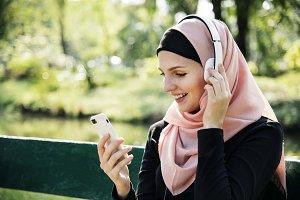 Islamic woman using mobile phone