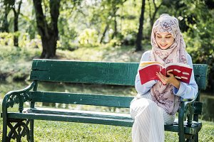 Woman reading the book at the park