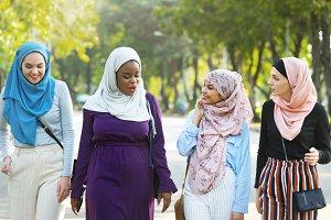 Islamic women friends walking