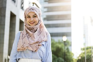 Islamic woman standing and smiling