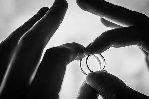 wedding rings in hands of the groom