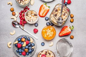 Muesli or granola jars and berries