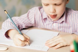 Little boy writing