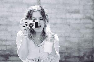 Girl taking photo holding milk