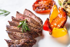 Beef steak and grilled vegetables. top view.