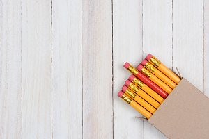 Red Pencil In Box With Yellow Ones