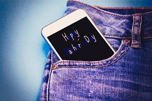 mobile phone in blue jeans pocket wi