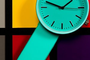 Clock on a  colored background. Abst