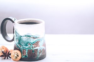 Beautiful cup of tea on a wooden background
