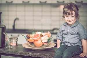 little girl with fruit