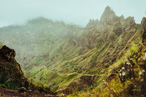 Harsh rugged mountain peaks of Xo-Xo Valley overgrown with verdant grass. Santo Antao Island, Cape Verde