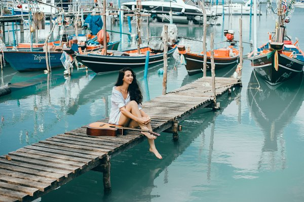 Holiday Stock Photos: SERGEY CAUSELOVE - Beauty woman posing in the pier