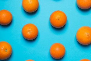 Fresh oranges on the blue background