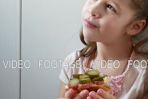 Close Up Girl eating sandwich in kitchen