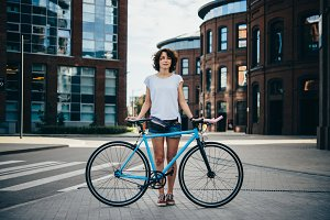 Girl stands with bicycle