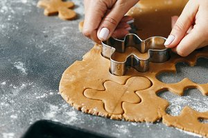 Women's hands cooking gingerbread