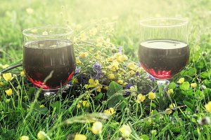 Red wine in two glasses in summer