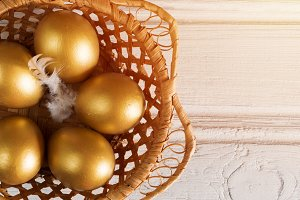 Easter eggs gold in a basket