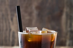 Iced coffee in glass on wooden table