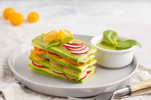 Raw zucchini lasagna with vegetables