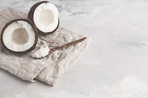open coconut with coconut shavings