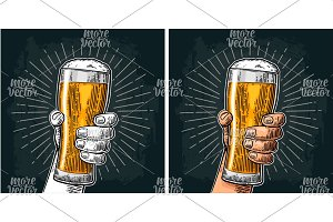 Male hand holding a beer glass with
