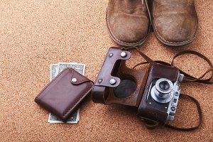 Set of men's accessories for the tourist on a white wooden background. The concept of fashion, leisure and travel.