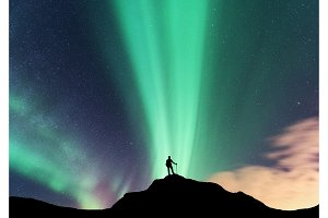 Aurora and silhouette of standing woman at night