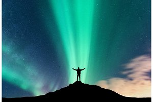 Aurora borealis and silhouette of standing man