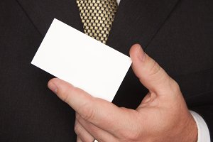 Businessman in Suit Tie Holds Card