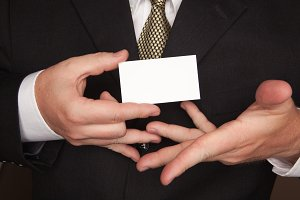 Businessman in Suit, Tie Holds Card