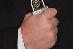Businessman in Suit Holds a Lock
