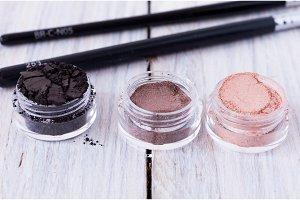 Three jars with women's cosmetics.