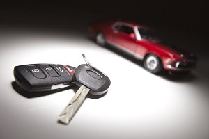 Car Keys and Red Sports Car