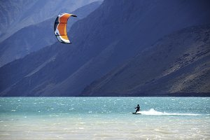 A kite surfer on the water in a Lake