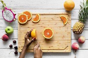 Cutting up healthy fresh oranges