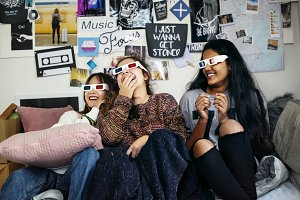 Teenage girls wearing 3d movie
