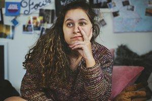 Confident teenage girl sitting